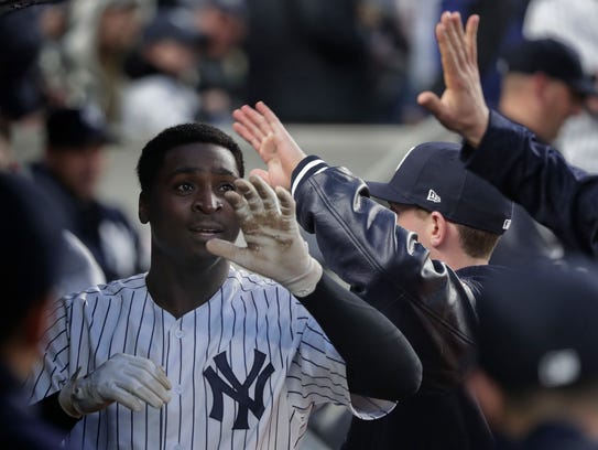 New York Yankees' Didi Gregorius celebrates with teammates