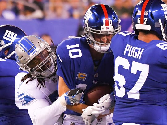 Lions defensive end Ziggy Ansah sacks Giants quarterback Eli Manning in the first half at MetLife Stadium on Sept. 18, 2017.