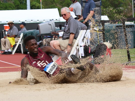 FSU's Corion Knight lands after pulling out his winning leap in the long jump at the ACC Outdoor Track & Field Championships.