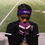 Benton Tigers' Shayla Lee tries to keep warm during half time at a soccer game at West Ouachita on Tuesday. West Ouachita varsity girls' soccer team defeated Benton 3-1.