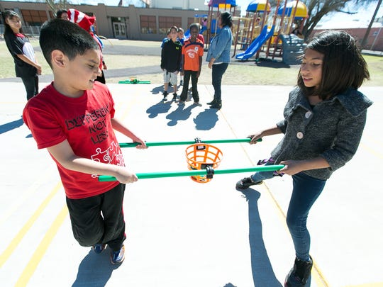 Central Elementary School students Andy Hernandez, 10, left, and Juliana Ruiz, 11, practice for Project UNIFY, an Autism Awareness Team Building Competition.