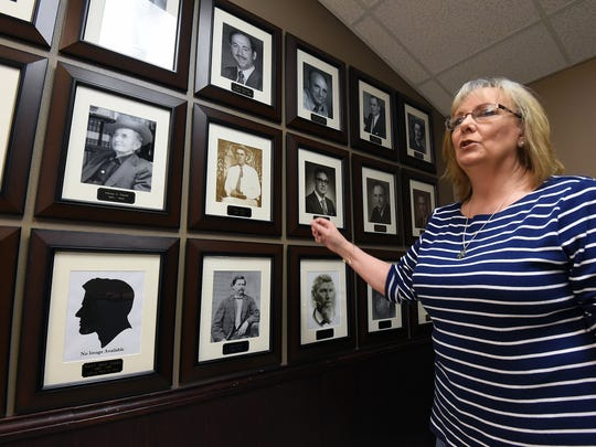 Maryanne Edge, a reserve deputy with the Baxter County Sheriff's Office, talks about a project she recently completed in which she compiled photographs of every sheriff in Baxter County history. The photographs are on display in the lobby of the Baxter County Sheriff's Office.