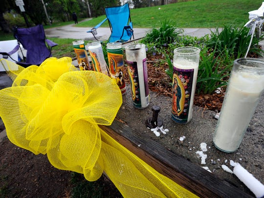 Candles on display near the Brenke Fish Ladder in north Lansing Tuesday. The family of Josephina Betancourt, who has been missing since April 25, has created a search headquarters next to the Fish Ladder parking lot..