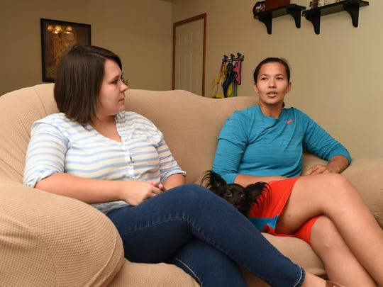 The same-sex relationship between Sarah Reynolds, left, and Nikki Mitchell places them among the minority in this ultra-conservative part of the Ozarks, as does Nikki's race and ethnicity.