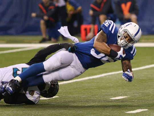 Indianapolis Colts running back Dan Herron dives towards the end zone in the second quarter. Indianapolis hosted Jacksonville at Lucas Oil Stadium on Sunday, November 23, 2014.