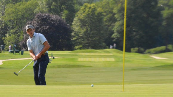 Scarsdale resident James Nicholas watches a putt from