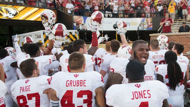 The Indiana football team celebrates in front of fans after Indiana upset Missouri, 31-27, in an NCAA college football game Saturday, Sept. 20, 2014, in Columbia, Mo.