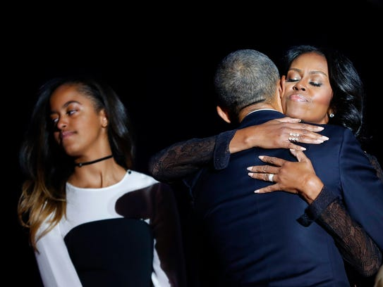 First lady Michelle Obama hugs her husband President