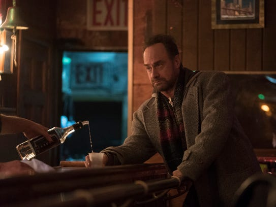 Nick (Christopher Meloni) puts aside the drinks to