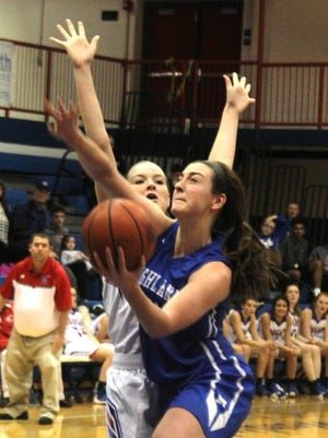 McKenzie Leigh won the game, 47-46, for Highlands with this driving layup.