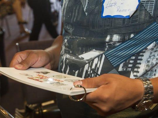 Ramon Alex Murillo reads through the cook books given