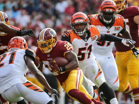 Cincinnati Bengals linebacker Kevin Minter (51) chases after Washington Redskins running back Chris Thompson (25) in the second quarter during the Week 3 NFL preseason game between the Cincinnati Bengals and Washington, Sunday, Aug. 27, 2017, at FedEx Field in Landover, Maryland.