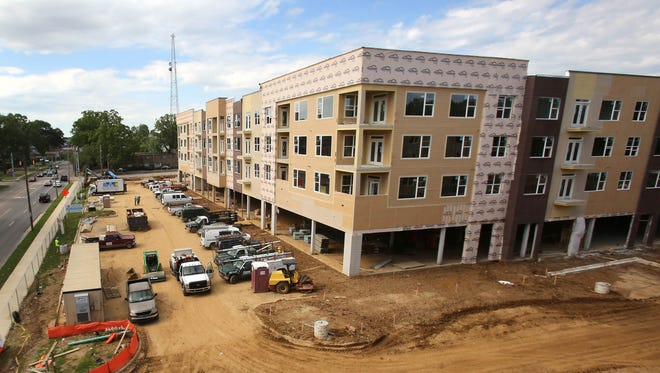 The mixed-use development in the University District called Highland Row is among 13 properties around the nation that owner Milhaus is offering for sale.