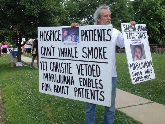 Jim Miller, of Toms River, protests medical marijuana laws outside the governor's town hall meeting in Haddon Heights on Wednesday.