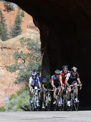 Five riders emerge from the tunnels in Red Canyon during