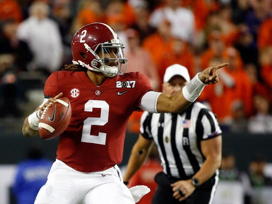 Jan 9, 2017; Tampa, FL, USA; Alabama Crimson Tide quarterback Jalen Hurts (2) points as he gets ready to throw the ball against the Clemson Tigers in the 2017 College Football Playoff National Championship Game at Raymond James Stadium. Mandatory Credit: Kim Klement-USA TODAY Sports