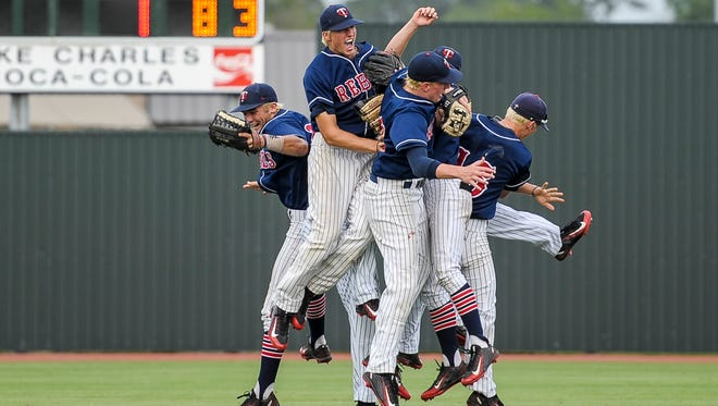 Teurlings Catholic defensive players celebrate following their 16-1 victory over Tioga in an LHSAA Class 4A semi-final playoff game at McMurry Park in Sulphur, LA, Thursday, May 14, 2015. Teurlings will play in the Class 4A state final on Saturday.