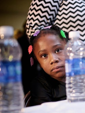 Coreona Jordan, 6, of Flint, is affected by lead, is