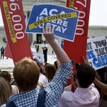 Supporters of the Affordable Care Act rally outside the Supreme Court on June 25, 2015, in Washington, D.C.