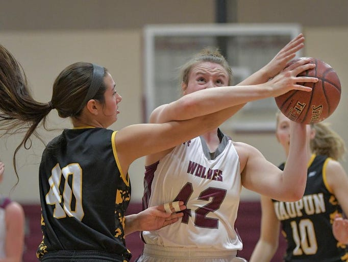 Sadie Kosciuk (42) of Winneconne gets fouled by Elyse
