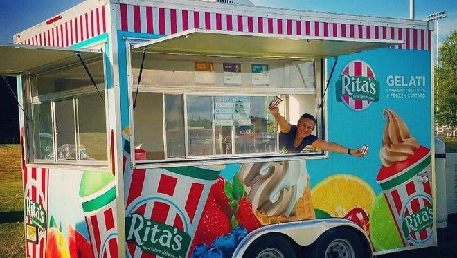 Hilda Colon of the Avenel section of Woodbridge with her Rita's Italian Ice trailer.