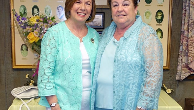 Mary Wolfe (left), a member of the Woman's Club of Vineland, is congratulated by club president Norene Ritter, on being elected president of the New Jersey State Federation of Women's Clubs.