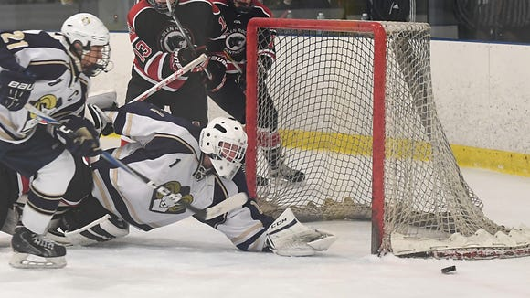 Glen Rock vs. Ramsey at the Ice Vault Arena in Wayne on Friday, Dec. 9, 2016.  R #1 Jonny Kopack reaches for the puck in the second period.