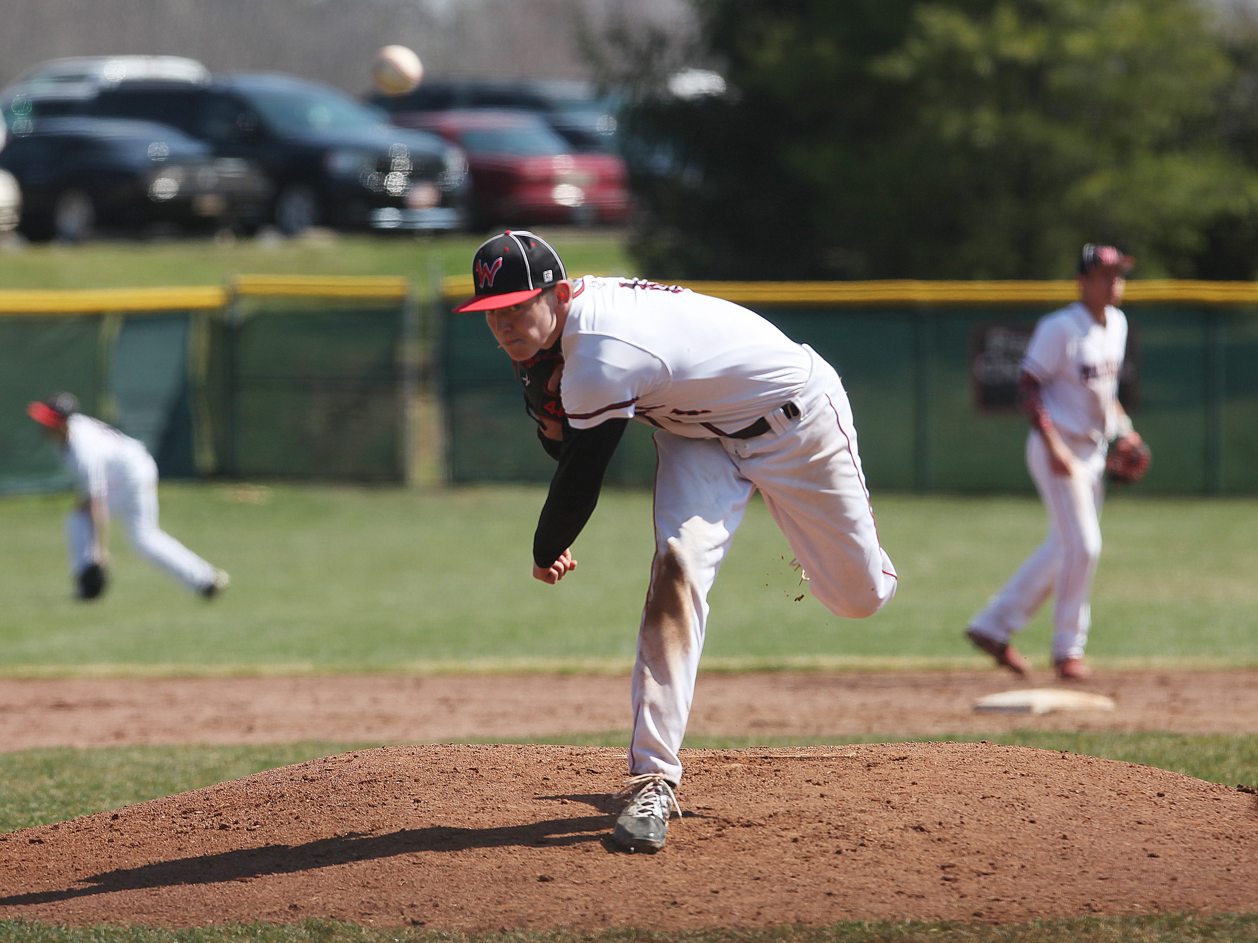 Wapahani pitcher Zack Thompson follows through on a pitch in a 10-0 win against Central Saturday.