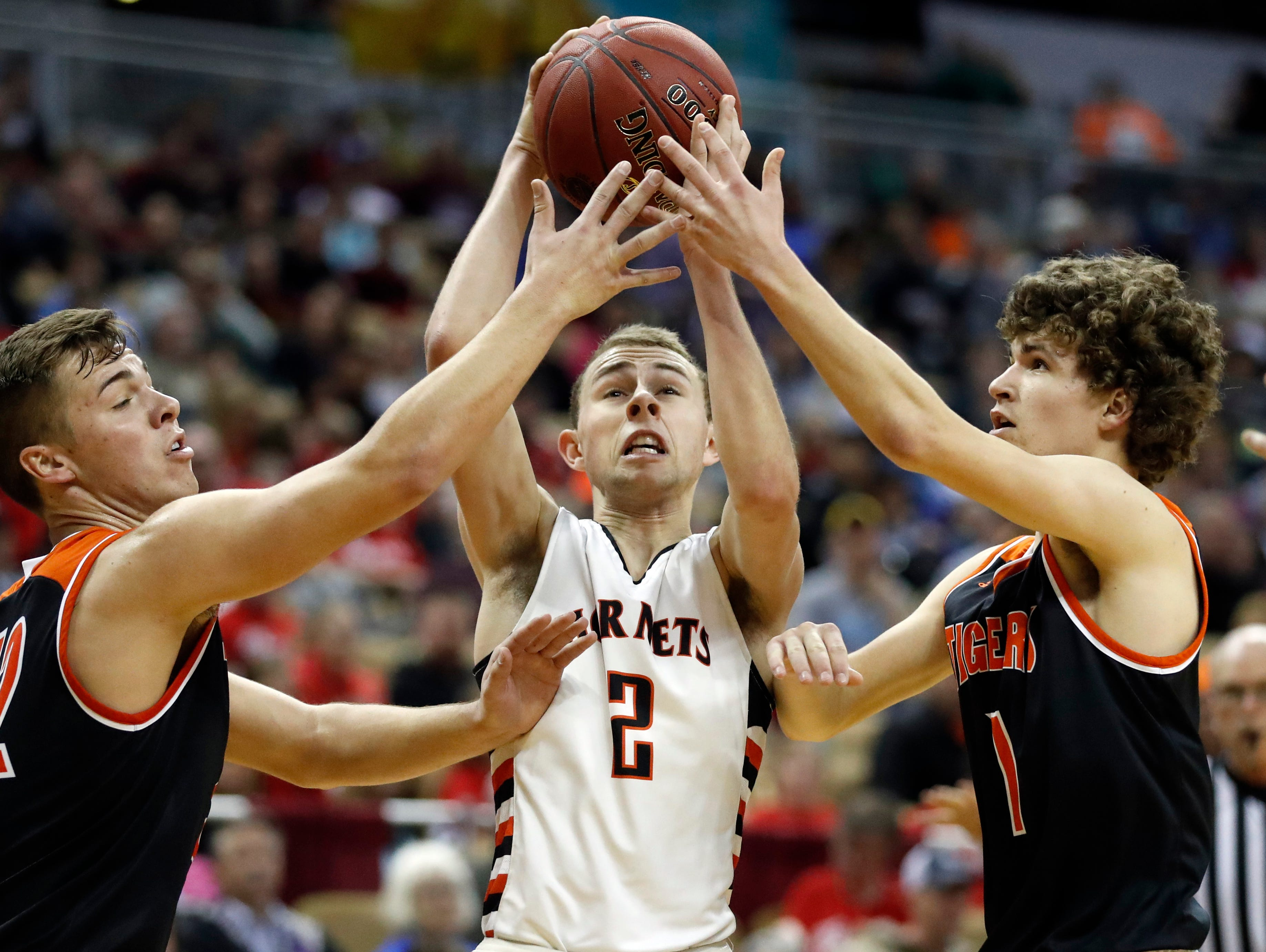 Advance's Preston Wuebker, center, tries to shoot between Walnut Grove's Logan Thomazin, left, and Cory Countryman during the second half of the Missouri Class 1 boys high school championship basketball game Saturday, March 11, 2017, in Columbia, Mo. Walnut Grove won 65-62. (AP Photo/Jeff Roberson)
