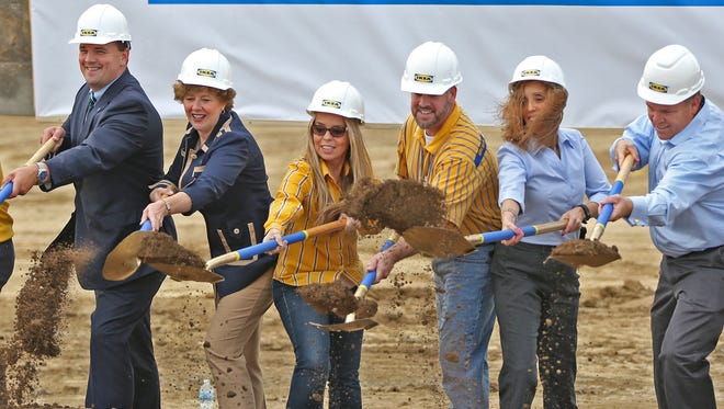 A variety of people from dignitaries, like Fishers Mayor Scott Fadness, from left, and Congresswoman Susan Brooks to IKEA staff throw dirt during the groundbreaking ceremony for IKEA in Fishers, Tuesday, October 18, 2016.