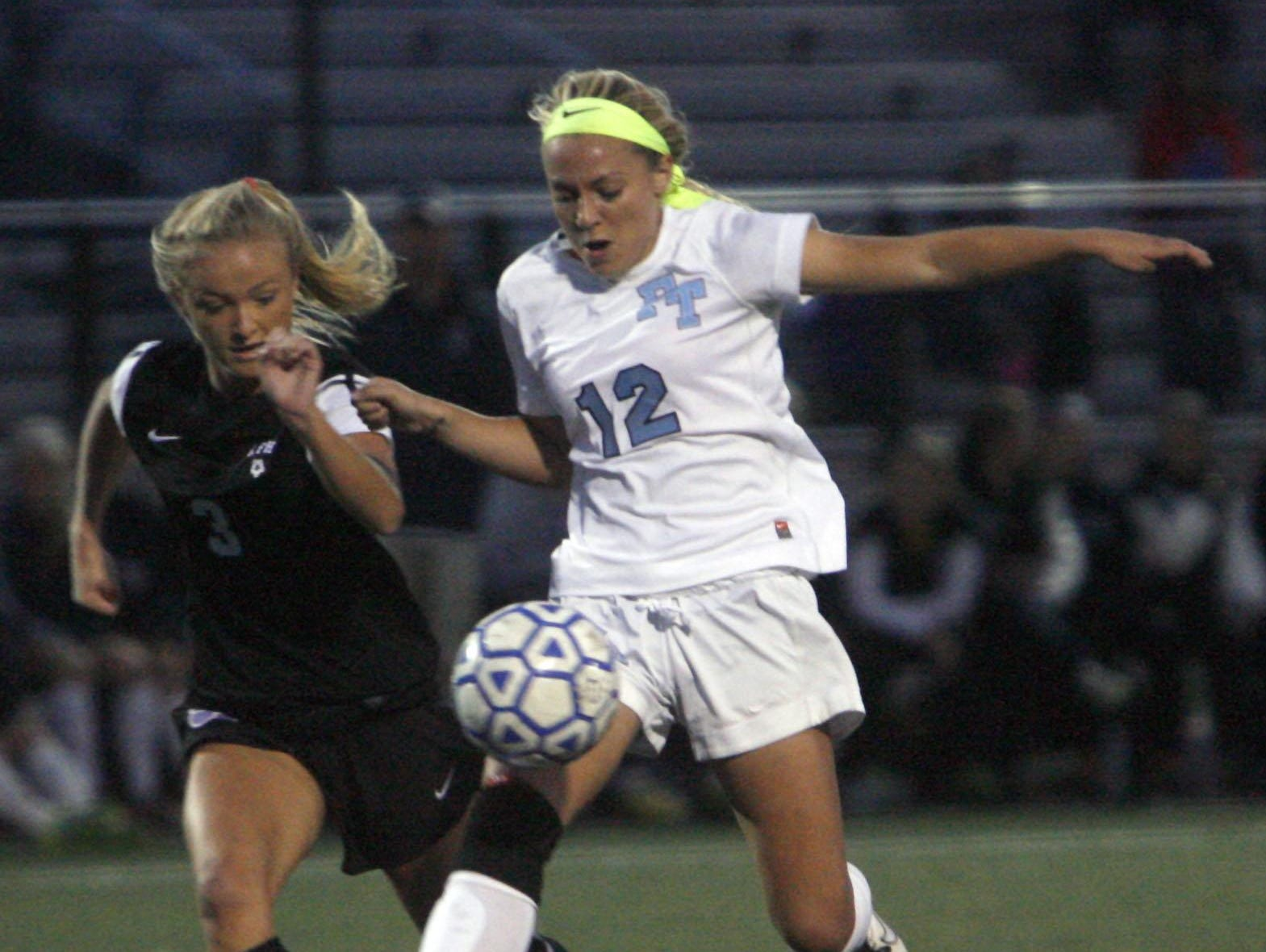 Rumson-Fair Haven's Jacqueline Littleson, left and Freehold Township's Lacey Powell (12) fight for control in the SCT Semifinal at Toms River North High School October 29, 2015.