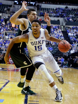 Duke's Jahlil Okafor drives around Michigan State's Gavin Schilling in the first half Tuesday. Okafor made 8 of 10 shots.