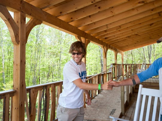 Former Olympic snowboarder Kevin Pearce, left, greets Will Halby of Zeno Mountain Farm in Lincoln, as they prepare for a week-long camp for traumatic brain injury survivors. Pearce suffered a traumatic brain injury in 2009 while attempting a Cab double cork in the halfpipe in Park City, Utah.