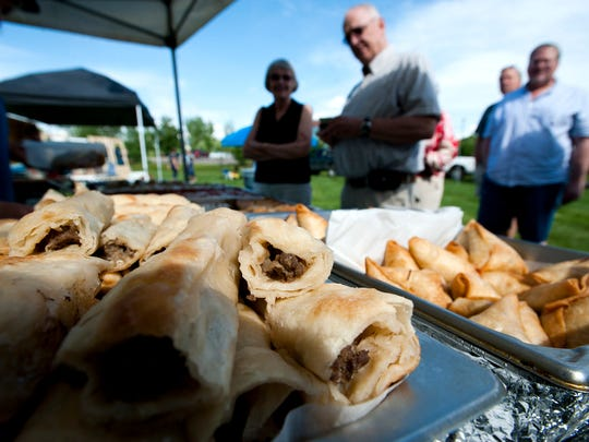 Beef Burek from Mediterranean Mix entices customers at the Williston Farmers Market on Wednesday June 18, 2014.