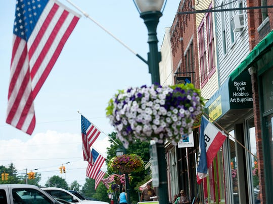 American flags decorate Main Street in Bristol on Monday June 30, 2014 in advance of the town's Independence Day celebration.