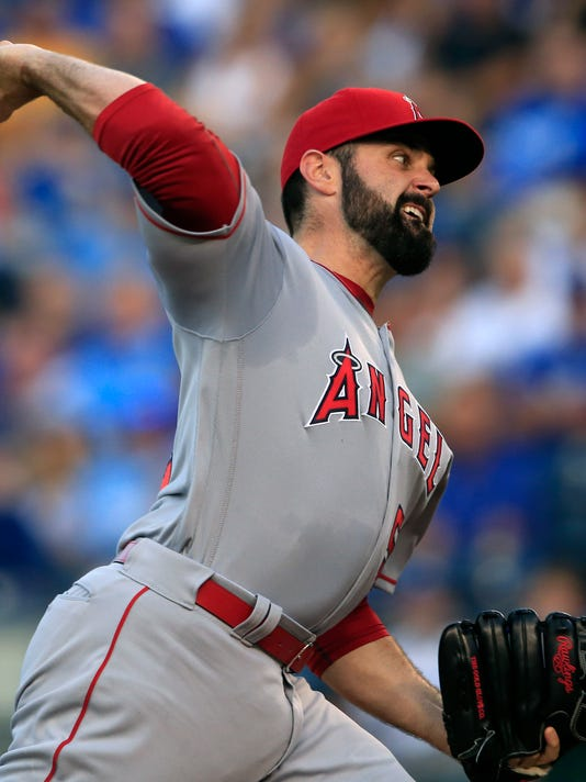 Los Angeles Angels starting pitcher Matt Shoemaker delivers to a Kansas City Royals batter during the first inning of a baseball game at Kauffman Stadium in Kansas City, Mo., Wednesday, July 27, 2016. (AP Photo/Orlin Wagner)