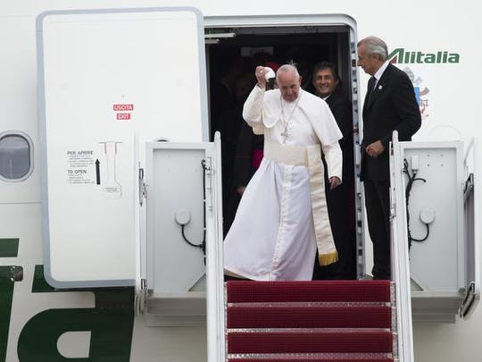 Pope Francis disembarks from his airplane upon arrival at Andrews Air Force Base in Maryland, September 22, 2015, on the start of a 3-day trip to Washington. AFP PHOTO / SAUL LOEBSAUL LOEB/AFP/Getty Images