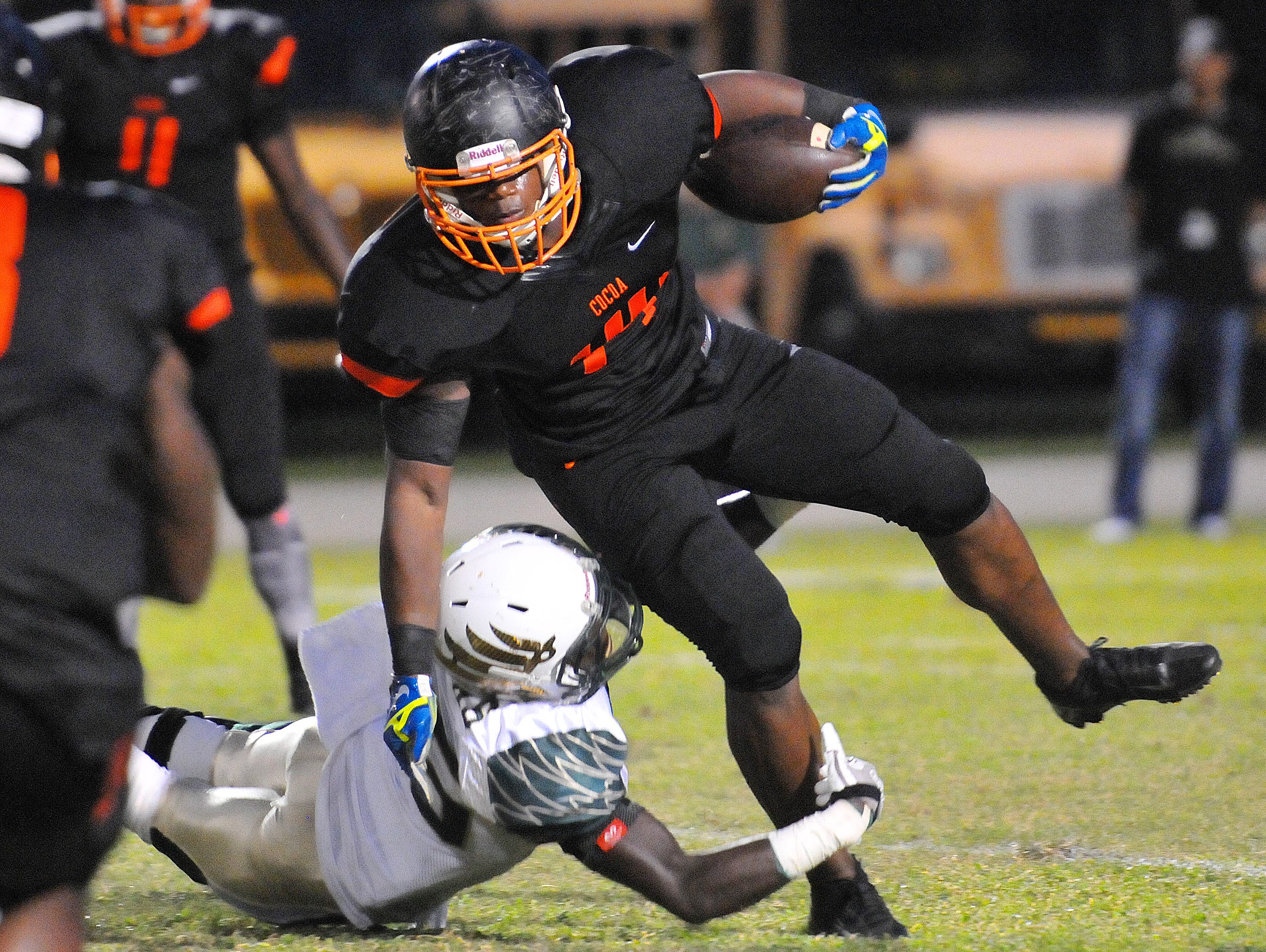 Cocoa High's Howard Stewart tries to pick up extra yards as Viera High's Jay Boyd holds on during Friday night's game.
