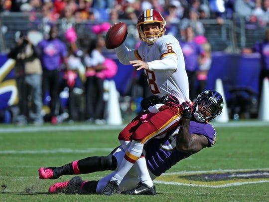 Washington Redskins quarterback Kirk Cousins (8) is sacked by Baltimore Ravens linebacker Terrell Suggs (55) at M&T Bank Stadium.