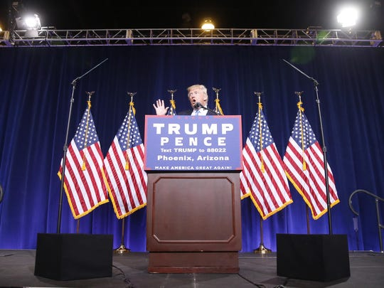 Republican presidential candidate Donald Trump speaks to a crowd at the Phoenix Convention Center on Aug. 31, 2016.