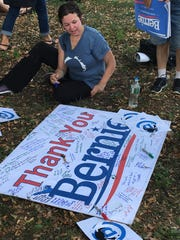 Supporters of Bernie Sanders signed a banner recognizing