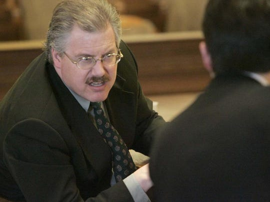 Calumet County District Attorney Ken Kratz talks with Steven Avery's attorney Dean Strang in a Manitowoc County Courtroom before Steven Avery's motions hearing in Manitowoc, WI on Friday March 17, 2006.
