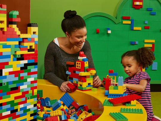 Children ages 2 to 5 can build with larger bricks in the Duplo area.
