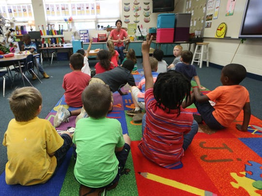 Children in kindergarten classes, like this one at Kate Sullivan Elementary are poised to see a new grading scale next year.