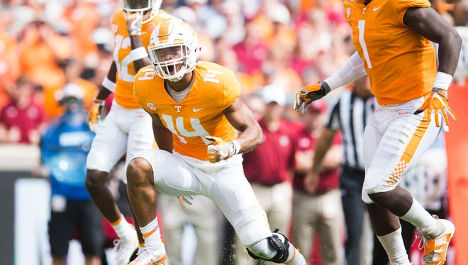 Tennessee linebacker Quart'e Sapp (14) celebrates a play during the first half of a Tennessee vs. South Carolina game at Neyland Stadium in Knoxville, Tenn. Saturday, Oct. 14, 2017.