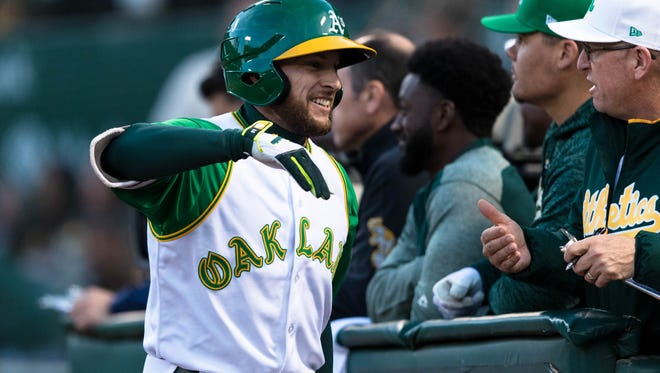 Apr 17, 2018; Oakland, CA, USA; Oakland Athletics second baseman Jed Lowrie (8) celebrates after hitting a solo home run against the Chicago White Sox in the first inning at Oakland Coliseum. Mandatory Credit: John Hefti-USA TODAY Sports