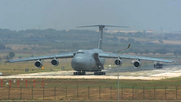 A U.S. Air Force  C-5 Galaxy cargo transport plane lands at Incirlik air base in Adana, Turkey, on Aug. 10, 2015. The base is used by the U.S.-led coalition to attack the Islamic State in Iraq and Syria.