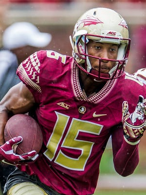 In this April 11, 2015, file photo, Florida State wide receiver Travis Rudolph run in the first half of the Florida State Garnet & Gold spring college football game in Tallahassee, Fla. Rudolph reunited with Bo Paske on Monday, Sept. 5, 2016,  before the fourth-ranked Seminoles face No. 11 Mississippi. Rudolph surprised Paske and his mother, Leah, by giving Bo a personalized Florida State jersey during an interview on ESPN at the team's hotel. Rudolph befriended Paske, a sixth-grader with autism, during a visit last Tuesday to Tallahassee's Montford Middle School when he ate lunch with Paske, who was sitting alone.