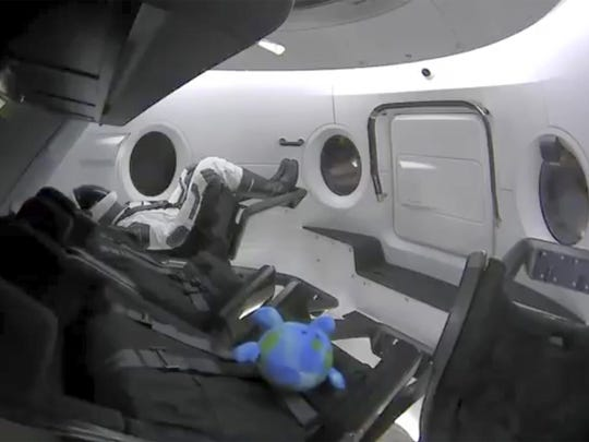 The capsule's lone passenger for launch — a mannequin