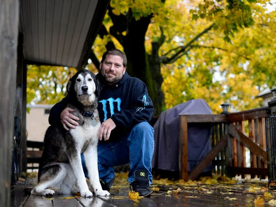 Tim Luckenbaugh and his dog, Diesel, pose for a photo